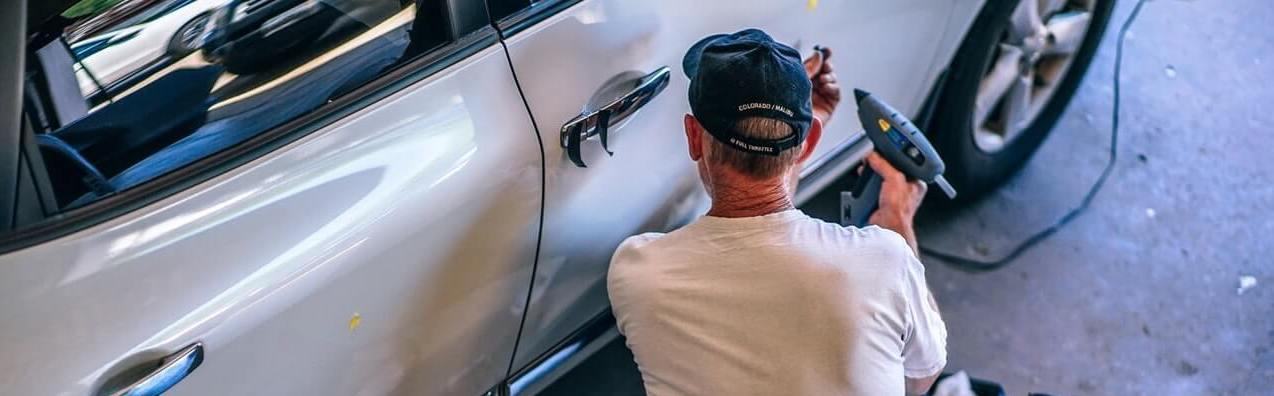 Mechanic checking car noises